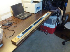 jig, made of a board, to align poles for marking